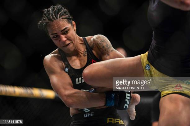 Brazilian fighter Viviane Araujo competes against Brazilian fighter Talita Bernardo during their women's bantamweight bout at the Ultimate Fighting...