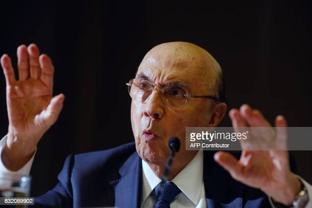 Brazilian Finance Minister Henrique Meirelles gestures as he announces the new fiscal target during a press conference at the Finance Ministry in...