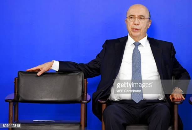 Brazilian Finance Minister Henrique Meirelles gestures during the announcement of the distribution of the results of the workers' severance guarantee...