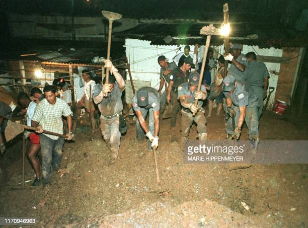 Brazilian Firemen search for victims in the middle of a mudslide in Campo Limpo slums south of Sao Paulo 28 February 2000 The mudslide which occured...