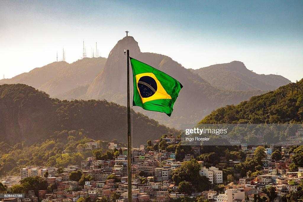 Brazilian flag and Corcovado : Stock Photo