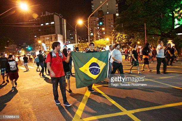 CONTENT] Brazilian Flag carried by manifestants