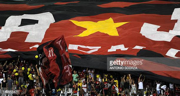 Brazilian Flamengo' supporters celebrates their victory by 10 over Ecuadorean Emelec in their Libertadores Cup football match on March 8 2012 at the...