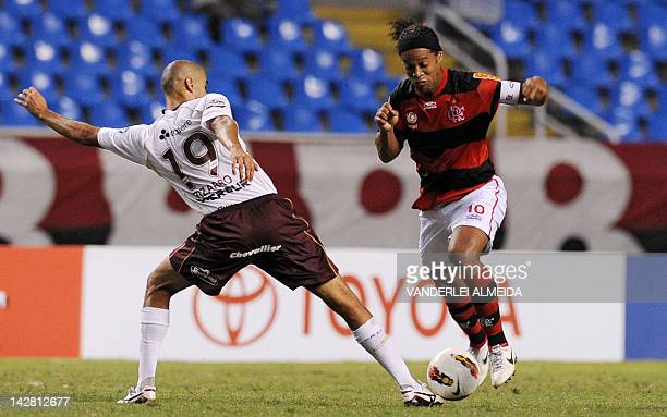 Brazilian Flamengo's player Ronaldinho Gaucho vies for the ball with Guido Pizarro of Argentina's Lanus during their Copa Libertadores football match...