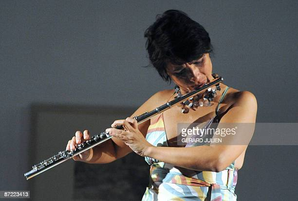 Brazilian flutist Andrea Ernest Dias performs during a recital at the Cantini Museum in Marseille Southern France on May 142009 AFP PHOTO /GERARD...