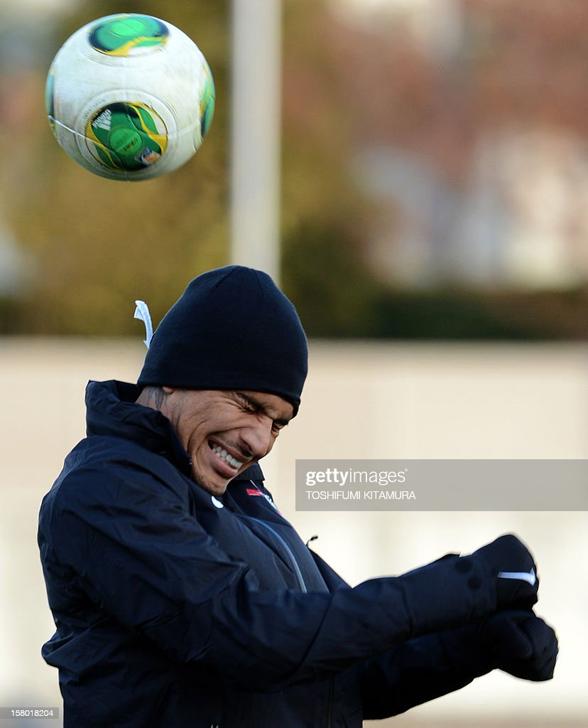 Brazilian football club team Corinthians forward Paolo Guerrero plays with the ball during their training session for the 2012 Club World Cup in Japan tournament at Kariya, Aichi prefecture on Dece...