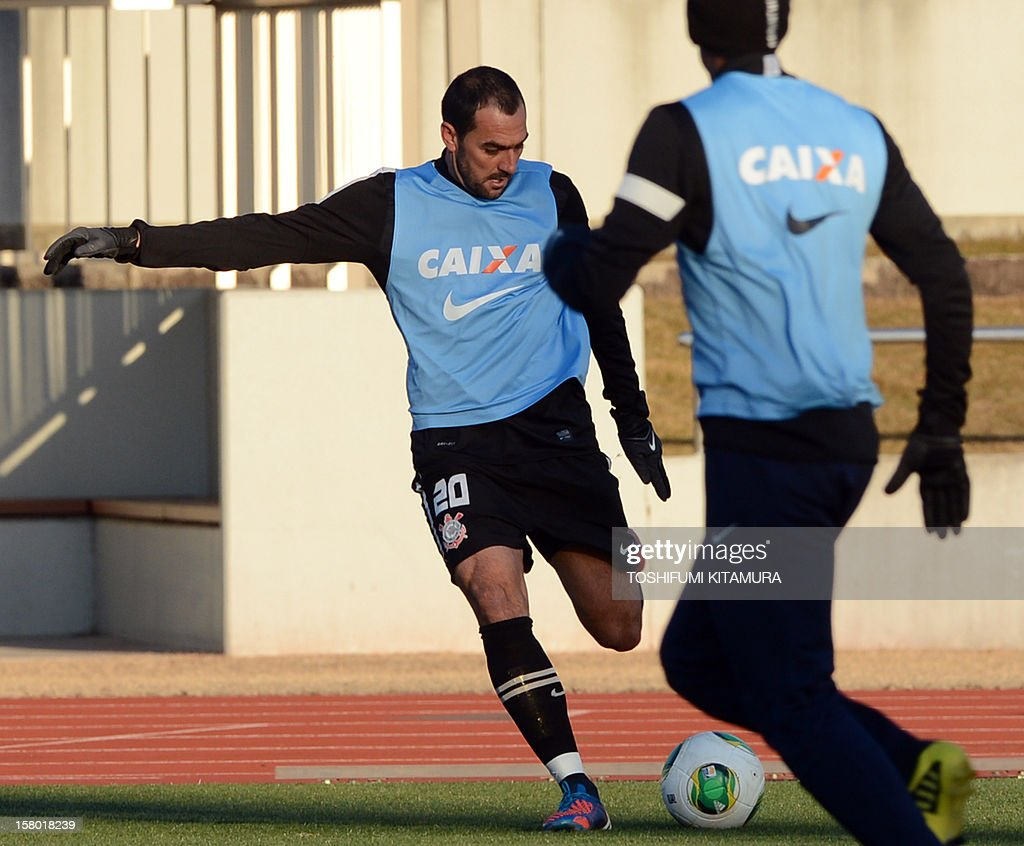 Brazilian football club team Corinthians midfielder Danilo (L) kicks the ball during their training session for the 2012 Club World Cup in Japan tournament at Kariya, Aichi prefecture on December 9, 2012. Corinthians will play in the semi-final match on December 12 at Toyota stadium.
