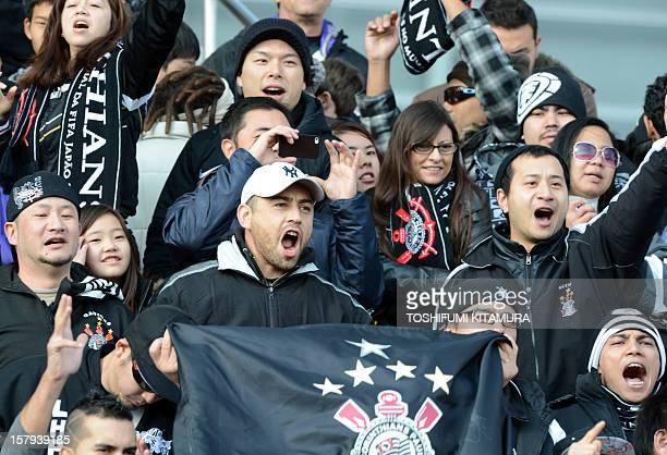 Brazilian football club team Corinthians supporters yell during the team's training session in Kariya Aichi prefecture on December 8 2012 while...