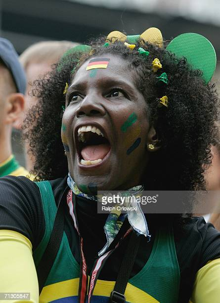 Brazilian football fan celebrates the goal of her team during a live-broadcast of the World Cup match on June 27, 2006 in Dortmund, Germany. Brazil...