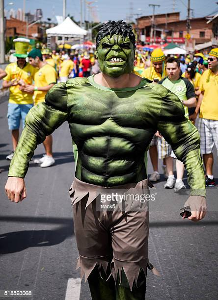 brazilian football fan dressed as the hulk - incredible hulk stock photos and pictures