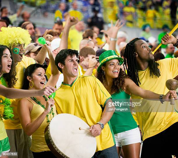 brazilian football fans dancing and cheering - international soccer event stock pictures, royalty-free photos & images