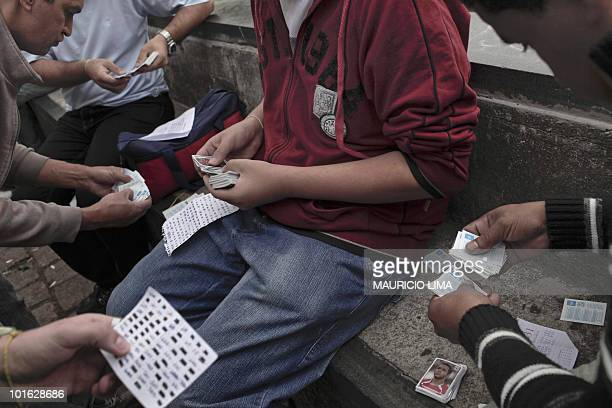 Brazilian football fans exchange 2010 FIFA World Cup stickers behind the Sao Paulo Art Museum in Sao Paulo Brazil on June 4 2010 The backside of the...