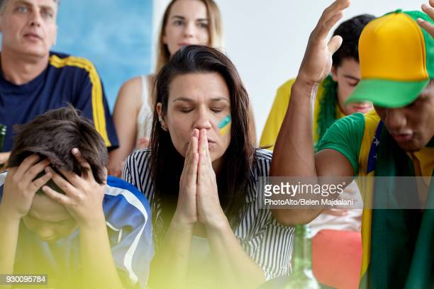 brazilian football fans looking upset while watching match at home - defeat stock pictures, royalty-free photos & images
