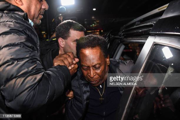 Brazilian football great Edson Arantes do Nascimento known as Pele arrives at Guarulhos International Airport in Guarulhos some 25km from Sao Paulo...
