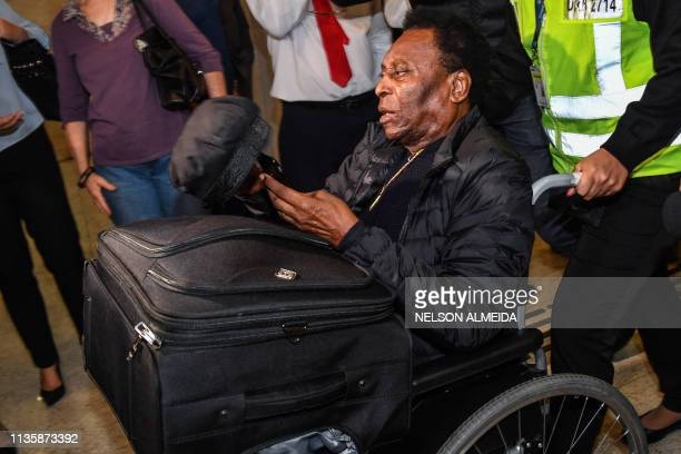 TOPSHOT Brazilian football great Edson Arantes do Nascimento known as Pele arrives at Guarulhos International Airport in Guarulhos some 25km from Sao...