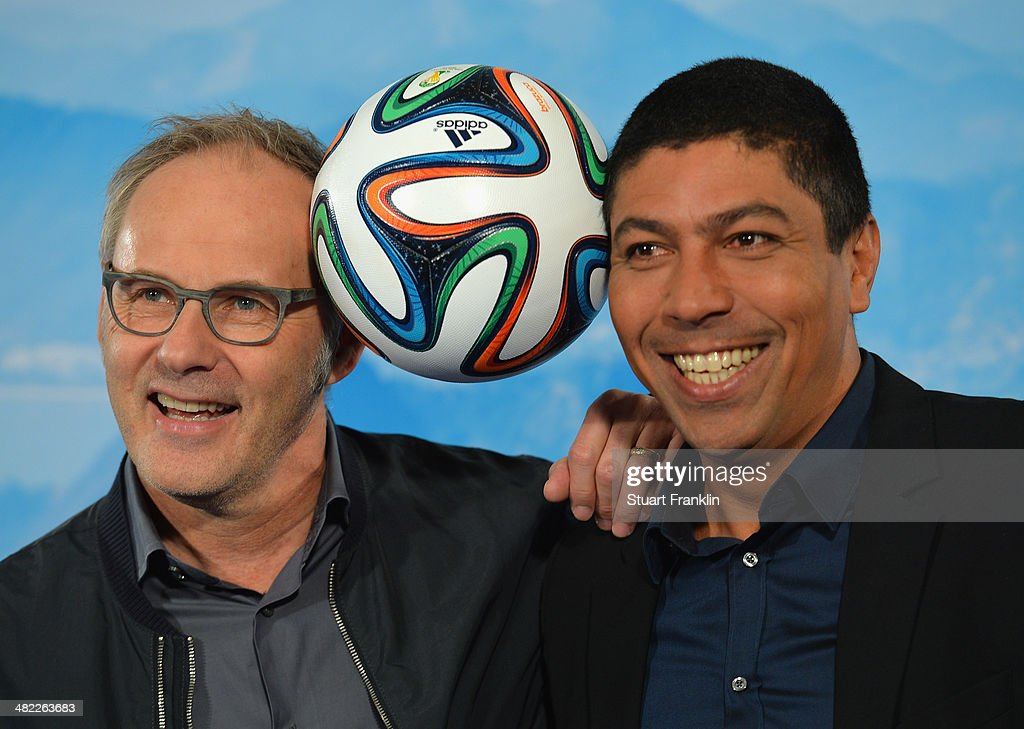 Brazilian football legend and television expert Giovanne Elber is pictured with ARD presenter Reinhold Beckmann during the ARD/ZDF FIFA World Cup 2014 team presentation event on April 3, 2014 in Hamburg, Germany.