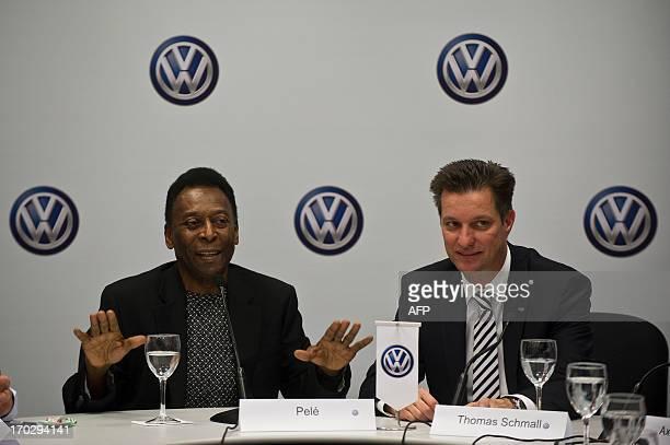 Brazilian football legend Edson Arantes do Nascimento, known as Pele , speaks nex to the president of Volkswagen Brazil Thomas Schmall during a press...