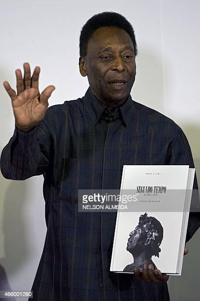 "Brazilian football legend Edson Arantes do Nascimento, known as ""Pele"", poses with his book ""Segundo Tempo"" , during the autograph ceremony in..."