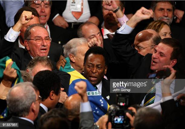 Brazilian football legend Pele cries as he and the Brazilian delegation celebrate after Rio De Janeiro won the vote to host the 2016 Olympic Games at...