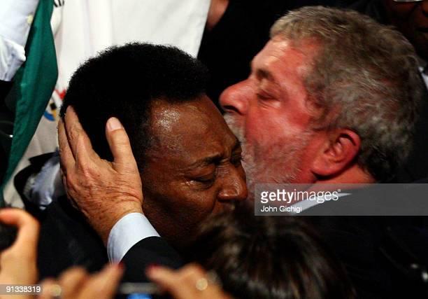 Brazilian football legend Pele is hugged by Brazilian President Luiz Inacio Lula da Silva after Rio De Janeiro won the vote to host the 2016 Olympic...