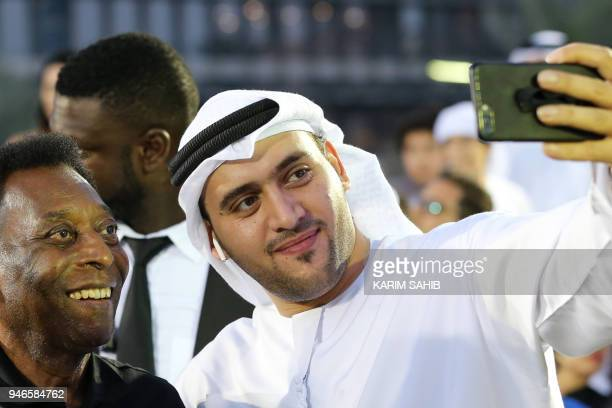 Brazilian football legend Pele poses for a photograph at the Dubai Opera gardens to attend a friendly football game in Dubai on April 15 2018 / AFP...