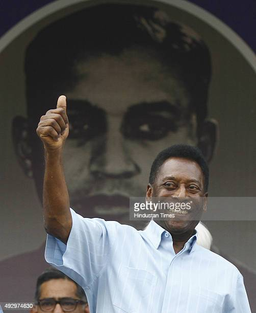 Brazilian football legend Pele reacts during the Under17 boys' final match of the Subroto Cup at the Ambedkar Stadium on October 16 2015 in New Delhi...