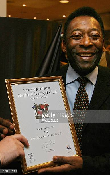 Brazilian football legend Pele receives membersip of Sheffield FC, the oldest football club in the world, at the opening of an exhibition at...