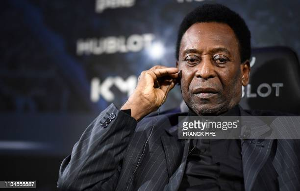 Brazilian football legend Pele take part in a meeting with Paris SaintGermain and France national football team forward Kylian Mbappe at the Hotel...