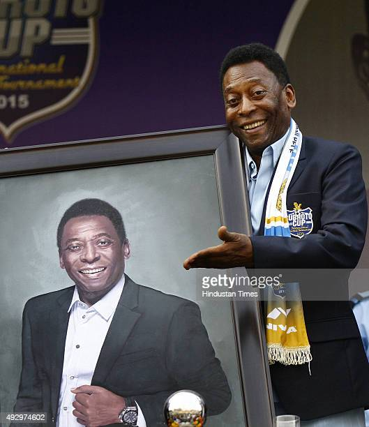 Brazilian football legend Pele with a portrait that was presented by the Air Chief Marshal Arup Raha during the Under17 boys' final match of the...