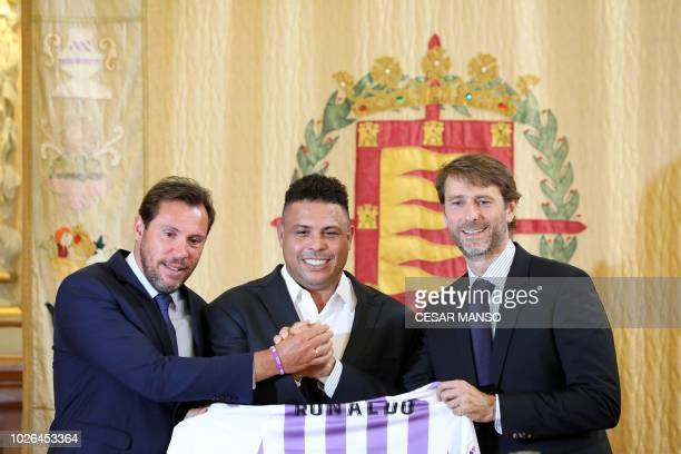 Brazilian football legend Ronaldo holds a symbolic Real Valladolid jersey as he poses with Valladolid mayor Oscar Puente and Real Valladolid...