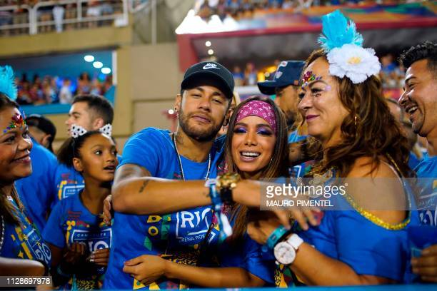 Brazilian football player Neymar attends the parade of the Vila Isabel samba school performance accompanied by Brazilian singer Anitta and his mother...