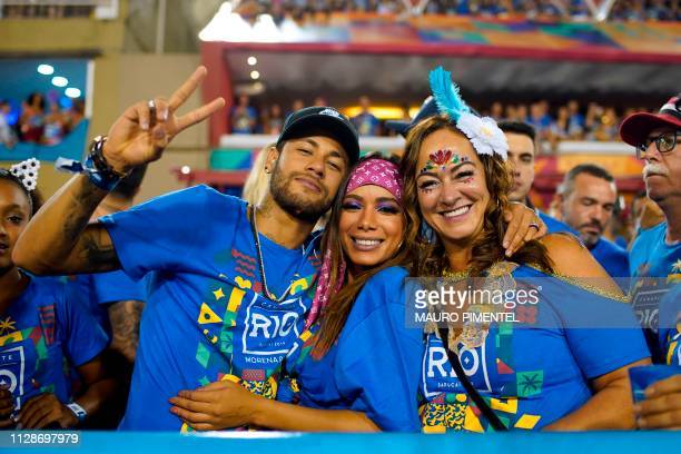TOPSHOT Brazilian football player Neymar attends the parade of the Vila Isabel samba school performance accompanied by Brazilian singer Anitta and...