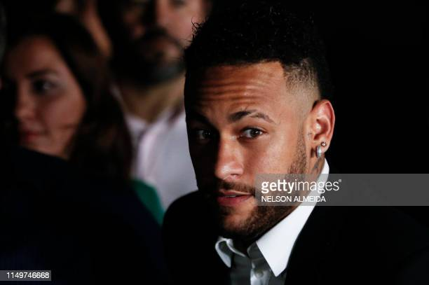 TOPSHOT Brazilian football player Neymar speaks to media members as he leaves on crutches from the Women's Defence Precinct in Sao Paulo Brazil on...