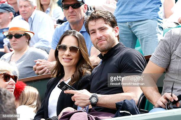 Brazilian Football player of PSG Maxwell and his wife Giulia Andrade attend the 2016 French Tennis Open Day Six at Roland Garros on May 27 2016 in...