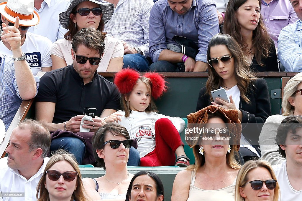 Brazilian Football player of PSG, Maxwell with his wife Giulia Andrade and their daughter attend the 2016 French Tennis Open - Day Six at Roland Garros on May 27, 2016 in Paris, France.