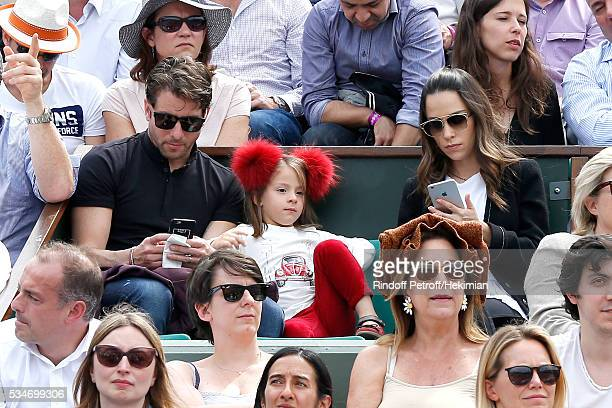 Brazilian Football player of PSG Maxwell with his wife Giulia Andrade and their daughter attend the 2016 French Tennis Open Day Six at Roland Garros...