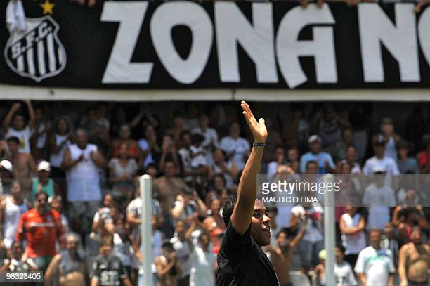 Brazilian football player Robinho waves to fans upon his arrival at Vila Belmiro stadium for his official presentation to the club, in Santos, some...