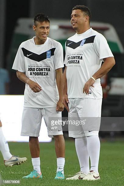 Brazilian football player Ronaldo and Neymar speak before their Match Against Poverty friendly football match led by the United Nations Development...