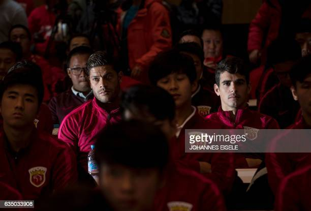 Brazilian football players Hulk and teammate Oscar of Shanghai SIPG attend a season launch event in Shanghai on February 13 2017 / AFP / Johannes...