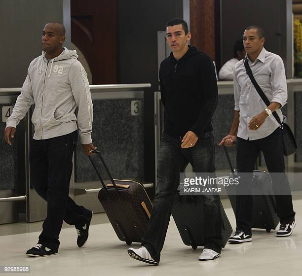 Brazilian football players Maicon Douglas Sisenando and Lucio and Gilberto Silva arrive at Doha airport on November 11 2009 Brazil will face England...