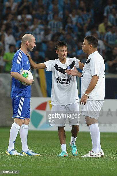 Brazilian football players Neymar and Ronaldo and French football player Zidane speaks before the second half during the Match Against Poverty...