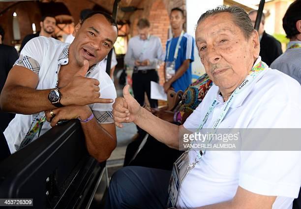 Brazilian football star Cafu and Uruguyan legend Alcides Edgardo Ghiggia pose for photogrpahers as they arrive where the Brazil 2014 FIFA Football...
