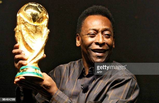 Brazilian football star Pele displays the FIFA World Cup during its presentation in Rio de Janeiro Brazil on February 6 2010 The cup is being...
