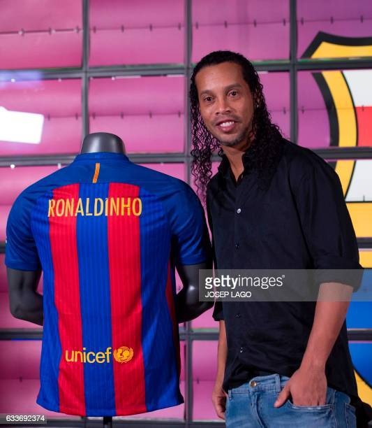 Brazilian football star Ronaldinho poses during his official presentation as new FC Barcelona ambassador at the Camp Nou stadium in Barcelona on...