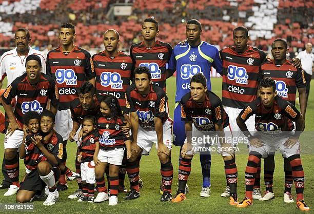 Brazilian football star Ronaldinho poses with teammates before the start of his first match playing for Rio de Janeirobased team Flamengo after...