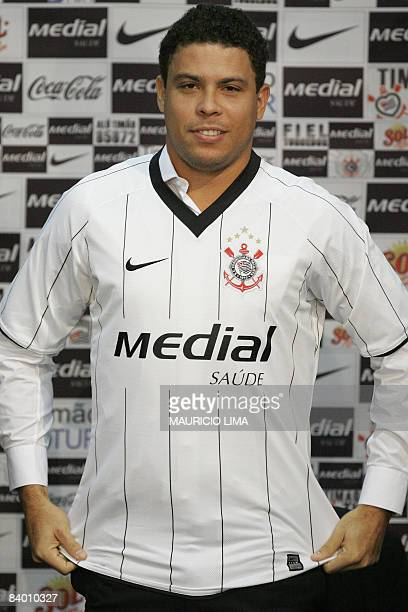 Brazilian football star Ronaldo poses with his new Corinthians club jersey during his official presentation at Corinthians club in Sao Paulo Brazil...