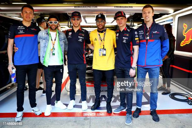 Brazilian football superstars Neymar and Dani Alves pose for a photo with Alexander Albon of Thailand and Scuderia Toro Rosso Pierre Gasly of France...