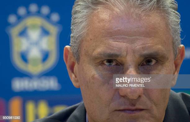 Brazilian football team head coach Tite looks on during a press conference to announce the list of players for the upcoming friendly matches against...