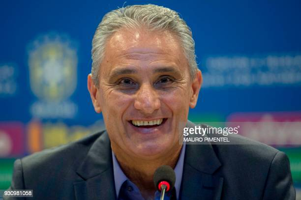 Brazilian football team head coach Tite smiles during a press conference to announce the list of players for the upcoming friendly matches against...