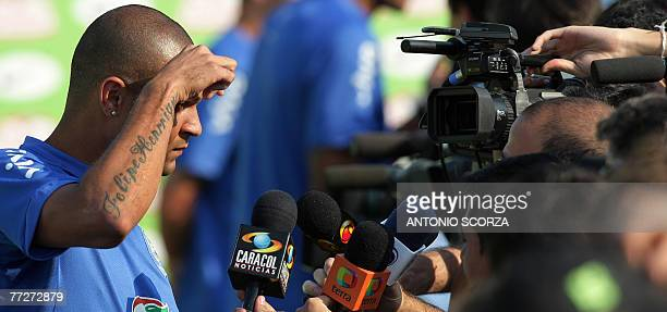 Brazilian footballer Afonso Alves reacts during a press conference at the mixed zone 11 October 2007 at the Teresopolis training center some 100km...